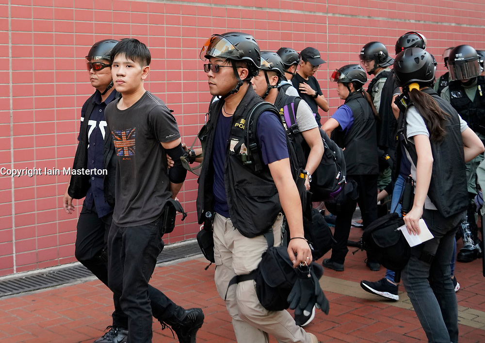 Tuen Mun, Hong Kong. 22 September 2019. Pro democracy demonstration and march through Tuen Mun in Hong Kong. Marchers protesting against harassment by sections of the pro Beijing community. Largely peaceful march had several violent incidents with police using teargas. Several arrests were made. Pictured; Arrest of protestor.  Iain Masterton Live News.