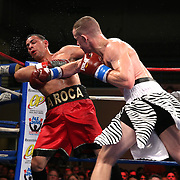 """Steed Woodall (white shorts) and Daniel Rodriguez fight during the """"Boxeo Telemundo"""" boxing match at the Kissimmee Civic Center on Friday, March 14, 2014 in Kissimmme, Florida. (Photo/Alex Menendez)"""