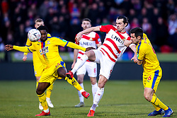 John Marquis of Doncaster Rovers challenges Scott Dann and Jeffrey Schlupp of Crystal Palace - Mandatory by-line: Robbie Stephenson/JMP - 17/02/2019 - FOOTBALL - The Keepmoat Stadium - Doncaster, England - Doncaster Rovers v Crystal Palace - Emirates FA Cup fifth round proper