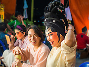 """26 NOVEMBER 2014 - BANGKOK, THAILAND: Performers put on their makeup before a Chinese opera performance at the Chow Su Kong Shrine in the Talat Noi neighborhood of Bangkok. Chinese opera was once very popular in Thailand, where it is called """"Ngiew."""" It is usually performed in the Teochew language. Millions of Chinese emigrated to Thailand (then Siam) in the 18th and 19th centuries and brought their culture with them. Recently the popularity of ngiew has faded as people turn to performances of opera on DVD or movies. There are about 30 Chinese opera troupes left in Bangkok and its environs. They are especially busy during Chinese New Year and Chinese holidays when they travel from Chinese temple to Chinese temple performing on stages they put up in streets near the temple, sometimes sleeping on hammocks they sling under their stage.      PHOTO BY JACK KURTZ"""
