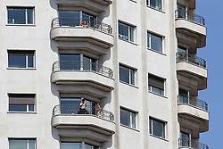 Daily life in Madrid, after new lockdown regulations in Spain, on May 02, 2020. Neighbors of Madrid rest on their balconies during the first day in which the general departures of almost the entire population are allowed, regulated by time bands. Two strips are established, in the morning and afternoon, so that those over 14 years old can go out to physically exercise individually or walk. These strips extend from 06:00 to 10:00 in the morning and from 20:00 to 23:00 at night. Separately and in attention to their special vulnerability, the strips between 10:00 a.m. and 12:00 p.m. and between 7:00 p.m. and 8:00 p.m. are defined specifically for the walks of people with special needs or those over 70 years. The walks with kids from 12:00 to 19:00. Health crisis due to the Covid-19 virus pandemic. Photo by Alejandro de Dios/AlterPhotos/ABACAPRESS.COM