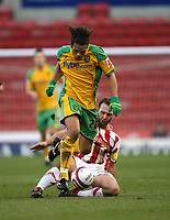 Photo: Paul Greenwood/Sportsbeat Images.<br /> Stoke City v Norwich City. Coca Cola Championship. 01/12/2007.<br /> Norwich's Darel Russell escapes the challlenge of John Eustace