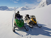 A snowmachine skier takes a break on the Tonsina Glacier, outside Valdez, Alaska