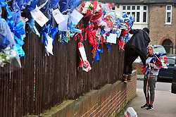 © Licensed to London News Pictures.10/04/2018<br /> HITHER GREEN, UK.<br /> BACK AGAIN..<br /> Henry Vincents friends and Family are Back at 5pm for the second time today to re-hang the Flowers..<br />  Hither Green Burglary Murder. South Park Crescent,Hither Green.<br />  Flowers outside the home of 78 year old Richard Osborn-Brooks who stabbed a burglar to death in his home.<br /> Photo credit: Grant Falvey/LNP