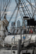 Canary Wharf through the rigging of the Mercedes - Royal Greenwich Tall Ships Festival with a fleet of square rigged ships moored on the Thames at Greenwich and Woolwich. The fleet includes two of the biggest Class A Tall Ships - the Dar Mlodziezy and Santa Maria Manuela - which are moored on Tall Ships Island in the river off Greenwich. Tall Ships Festival Day on Saturday 29 August featured free family entertainment and the chance to enjoy a taste of life on the high seas.