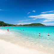 Swimmers enjoy the warm tropical waters of Hawksnest Bay on St John in the US Virgin Islands.