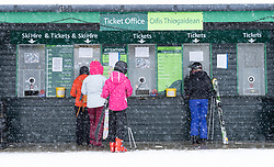 Glenshee, Scotland, UK. 16 March, 2019. Snow on high ground in Scotland meant skiing conditions at Glenshee Ski Centre in Aberdeenshire was good and hundreds of skiers made the most of excellent skiing conditions after a slow start to the Scottish ski season due to lack of snow. Skiers buying ski passes for ski slopes