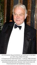 SIR RICHARD MacCORMAC at a dinner in London on 30th May 2002.PAN 86