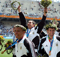 28/08/04 - ATHENS - GREECE -  - OLYMPIC FOOTBALL - FINAL MATCH - MENS  -  <br />ARGENTINA (1) Vs. PARAGUAY (0) At the Olympic Stadium in Athens. Argentine win the goal medal<br />Argentine players celebration. Here CLEMENTE RODRIGUEZ - CARLOS TEVEZ and JAVIER MASCHERANO.<br />© Gabriel Piko / Argenpress.com / Piko-Press