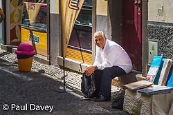A man rests in Old Town, Funchal, Madeira. MADEIRA, September 26 2018. © Paul Davey