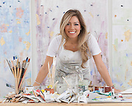 Michelle Sakhai is an artist who creates her paintings on canvas with oil and metal leaf.