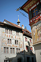 A warm, sunny view of Fresco Murals.  These murals are found outside of the historic Hotel and Restaurant Adler building in Stein em Rhein, Switzerland.