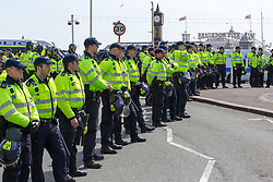 © Licensed to London News Pictures . 21/04/2013 . Brighton , UK . Hundreds of police were deployed on the beach front to keep the two sides apart . Nationalist group March for England hold a march along Brighton seafront today (Sunday 21st April) . The group was supported by supporters of the English Defence League and opposed by anti fascist and left wing groups . The annual march takes place close to St George's Day and frequently results in scuffles and violence between opposing groups and police . Photo credit : Joel Goodman/LNP