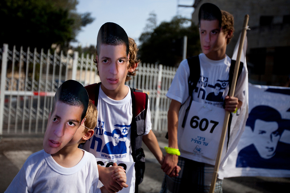 Israelis wear masks bearing the image of Israeli captured soldier Gilad Shalit during a human chain protest in which they circled the Prime Minister's residency in Jerusalem, on August 3, 2010, calling for Shalit's release and marking 1500 days since his abduction by Palestinian militants in June 2006.