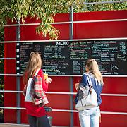 Girls read chalk board menu in Gorky park, Moscow