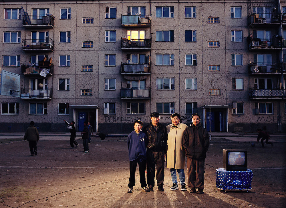 From coverage of revisit to Material World Project family in Ulaanbaatar, Mongolia in 2001. The Batsuuri family, with whatever new possessions (only a color TV set) they have acquired since the shooting of the photograph of the family with all of its possessions for the 1994 book Material World: A Global Family Portrait.