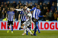 Sheffield United forward Gary Madine (14) and Sheffield Wednesday forward Dominic Iorfa (27)  contest a loose ball  during the EFL Sky Bet Championship match between Sheffield Wednesday and Sheffield United at Hillsborough, Sheffield, England on 4 March 2019.