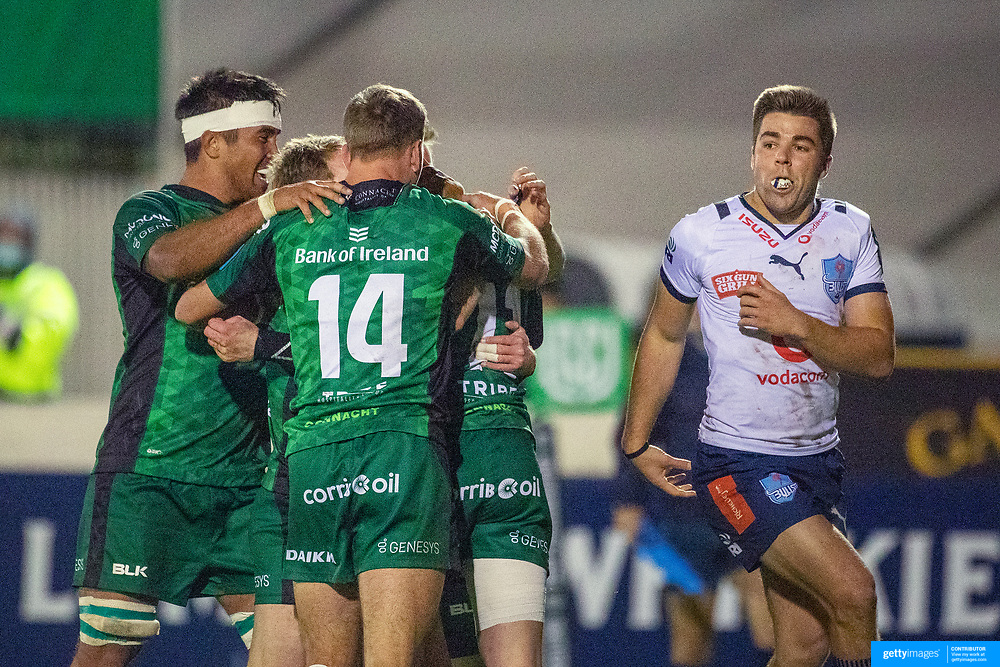 GALWAY, IRELAND:  October 01:   Mack Hansen #11 of Connacht is congratulated by team mates after scoring a spectacular try as  Zak Burger #9 of Vodacom Bulls looks on during the Connacht V Vodacom Bulls, United Rugby Championship match at The Sportsground on October 1st, 2021 in Galway, Ireland. (Photo by Tim Clayton/Corbis via Getty Images)