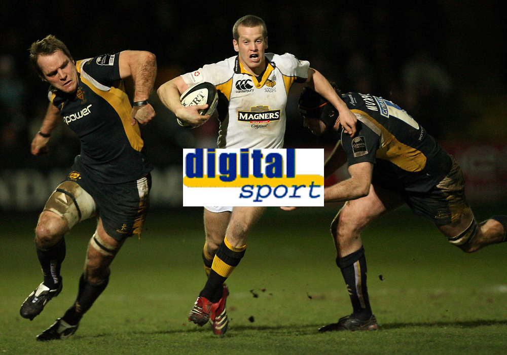 Photo: Rich Eaton.<br /> <br /> Worcester Rugby v London Wasps. Guinness Premiership. 26/01/2007. Dave Walder of Wasps, centre, tackled by Phil Murphy right and Kai Horstmann left