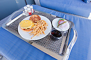 Burger, Egg and fries on a room service tray in a luxury hotel