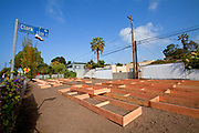 Planting beds being built at the Venice garden on April 16, 2010. The Venice Garden broke ground in April, 2010. Soil tests revealed high levels of arsenic and lead because of previous uses which included a railroad line going through the lot. Steps were taken which included adding protective layers and adding new soil. Planting began in August and the first harvest was in October, 2010. Venice, California, USA