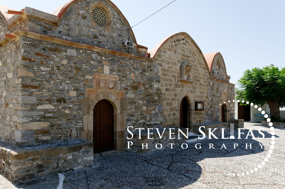 Rhodes. Greece. The Byzantine Church of the Dormition of the Virgin (monastery of metamorphosis) in the village of Asklipeio. Dating from 1060, the church is built in the shape of a cross and inside are superb 15-17th century frescoes depicting scenes from the Old Testament which are the most impressive in Rhodes. The island of Rhodes is the largest of the Dodecanese Island group and one of the most popular Greek Islands.