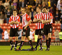 Photo. Glyn Thomas, Digitalsport<br /> NORWAY ONLY<br /> <br /> Sunderland v Crystal Palace. <br /> Division 1 Playoffs, second leg. 17/05/2004.<br /> Sunderland players can hardly bear to watch as they are knocked out of the playoffs on penalties.