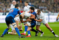England Lock George Kruis is tackled by France Number 8 Loann Goujon and Scrum-Half Maxime Machenaud - Mandatory byline: Rogan Thomson/JMP - 19/03/2016 - RUGBY UNION - Stade de France - Paris, France - France v England - RBS 6 Nations 2016.