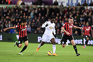 Wilfried Bony of Swansea city ©looks to go past Richard Dunne of QPR. Barclays Premier league match, Swansea city v Queens Park Rangers at the Liberty stadium in Swansea, South Wales on Tuesday 2nd December 2014<br /> pic by Andrew Orchard, Andrew Orchard sports photography.