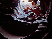 Sculptured chamber in a slickrock slot canyon, Colorado Plateau of Northern Arizona.   PW