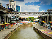 05 JUNE 2015 - KUALA LUMPUR, MALAYSIA: The Klang River as it flows past Pasar Seni light rail station and through Kuala Lumpur. The river is badly polluted as it flows through KL and not used for recreational purposes.     PHOTO BY JACK KURTZ