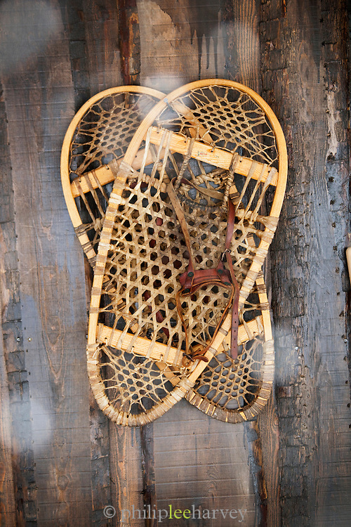 Old wooden snow shoes hang on the wall, now as decoration, at an Ice Hotel in Kirkenes in the Finnmark region, northern Norway