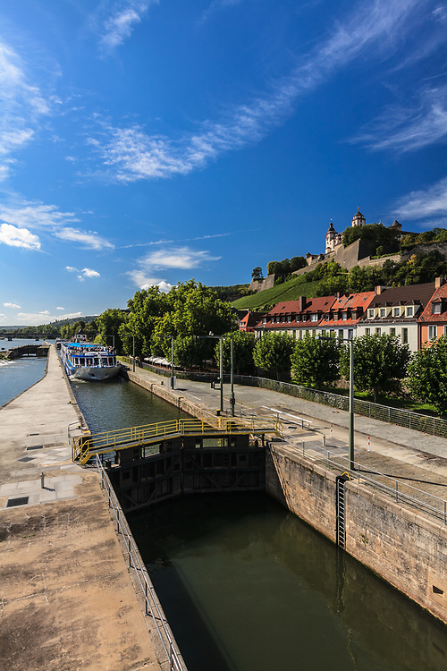 The passenger ship on the canal lock Würzburg, Germany. The scenic river cruise among the most picturesque landscapes leads even to Vienna, Austria.