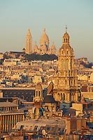 France, Paris (75), la basilique du Sacré-Cœur de Montmartre et le clocher de l'église de la Trinité en premier plan // France, Paris, Sacre Coeur Basilique and Trinite church