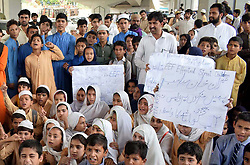 May 23, 2019 - Pakistan - PESHAWAR, PAKISTAN, MAY 22: Students of Private Schools are holding protest .demonstration for acceptance of their demands, near Khyber Pakhtunkhwa Assembly in .Peshawar on Wednesday, May 22, 2019. (Credit Image: © PPI via ZUMA Wire)