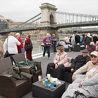 Participants enjoy a boat ride on river Danube with Chain Bridge in the background during the International Day for Older Persons in Budapest, Hungary on Oct. 1, 2018. ATTILA VOLGYI