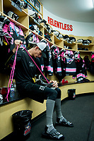 KELOWNA, CANADA - OCTOBER 21: Nolan Foote #29 of the Kelowna Rockets laces his skates for Pink the Rink fundraiser night for the Canadian Cancer foundation on October 21, 2017 at Prospera Place in Kelowna, British Columbia, Canada.  (Photo by Marissa Baecker/Shoot the Breeze)  *** Local Caption ***