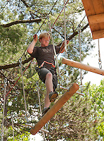 Chris Bobotas of Gilford takes on the final and most challenging black course at Gunstock Mountain Resort's Treetop Adventures over the July 4th holiday weekend.  (Karen Bobotas/for the Laconia Daily Sun)