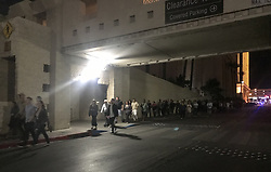 Oct. 2, 2017 - Las Vegas, Nevada, USA - People evacuate after the shooting in Las Vegas, the United States. At least 50 people were killed and over 200 others wounded in a mass shooting at a concert Sunday night outside of the Mandalay Bay Hotel in Las Vegas in the U.S. state of Nevada.  (Credit Image: © Huang Chao/Xinhua via ZUMA Wire)