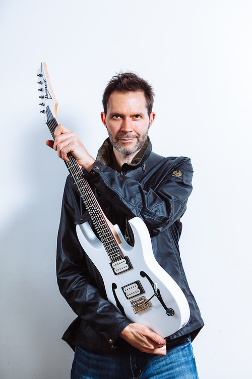 Paul Gilbert (Mr. Big, Racer X) photographed in a parking garage in Portland, OR for Guitar Player Magazine's Oct 2016 cover.
