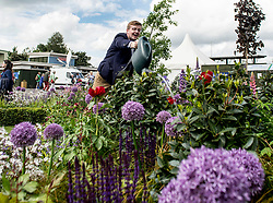 To mark it's centenary, the Commonwealth War Graves Commision (CWGC) has teamed up with Glen Art and the Wilfred Owen Association to create a remembrance garden at the annual Gardening Scotland event. Robert Ross from the CWGC is pictured keeping the plants well watered.<br /> © Dave Johnston/ EEm