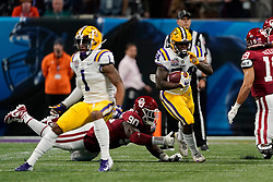 Chris Curry #24 of the LSU Tigers runs the ball during the first half against the Oklahoma Sooners in the 2019 College Football Playoff Semifinal at the Chick-fil-A Peach Bowl on Saturday, Dec. 28, in Atlanta. (Paul Abell via Abell Images for the Chick-fil-A Peach Bowl)