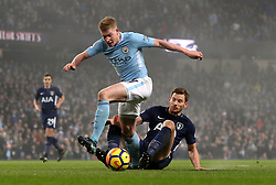 Tottenham Hotspur's Jan Vertonghen brings down Manchester City's Kevin De Bruyne to concede a penalty during the Premier League match at the Etihad Stadium, Manchester.