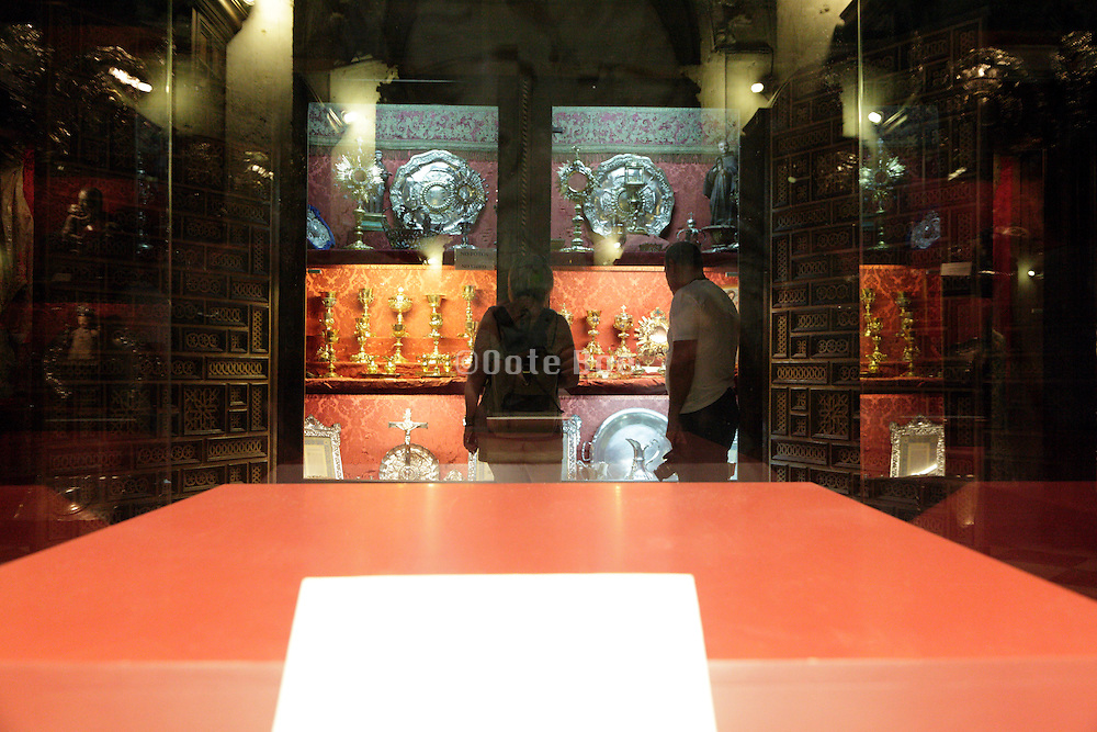 religious art display with empty glass cabinet in front