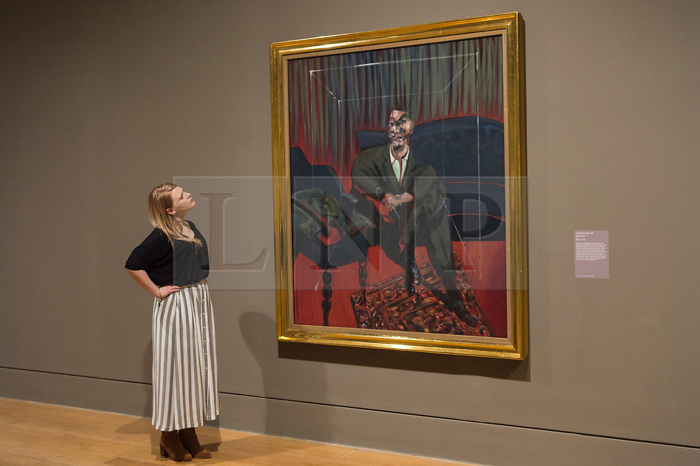 © Licensed to London News Pictures. 03/04/2017. Museum staff views a painting titled Seated Figure by artist Francis Bacon showing as part of Tate Britain's Queer British Art exhibition. London, UK. Photo credit: Ray Tang/LNP