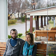 RALEIGH, NC - FEBRUARY 23: Andrew (left) and Kelly Hudgins sit on the swing outside of their home with their on February 23, 2019 in Raleigh, NC. (Logan Cyrus for The New York Times)