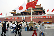 Japanese flags flutter over Tiananmen Gate for the visiting of Japan's new Prime Minister Shinzo Abe to Beijing Octiber 8, 2006. Japan and China agreed to improve frayed relations and said North Korea must not test a nuclear weapon in newly elected Japanese Prime Minister Shinzo Abe's first visit to Beijing.