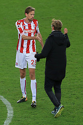 29th November 2017 - Premier League - Stoke City v Liverpool - Peter Crouch of Stoke shakes hands with Liverpool manager Jurgen Klopp at the end of the match - Photo: Simon Stacpoole / Offside.