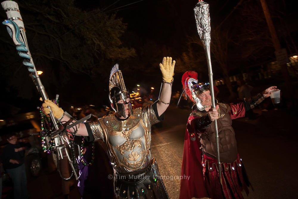 The Krewe of Flambeaux marches down Hyacinth Street at the start of the 25th annual Krewe of Southdowns Mardi Gras parade in Baton Rouge, La.
