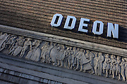 Exterior of an Odeon cinema in central London. The Saville Theatre is a former West End theatre at 135 Shaftesbury Avenue in the London Borough of Camden. The exterior of the theatre retains many of the 1930s details, although the wrought iron window on the frontage has been replaced by glass blocks. A sculptured frieze by British sculptor Gilbert Bayes around the building for nearly 130 feet (40 m), remains and represents 'Drama Through The Ages'. The theatre opened in 1931, and became a music venue during the 1960s. In 1970 it became the two cinemas ABC1 Shaftesbury Avenue and ABC2 Shaftesbury Avenue, which in 2001 were converted to the four-screen cinema Odeon Covent Garden. Odeon Cinemas is a British chain of cinemas operating in the United Kingdom and Ireland. The company is one of the largest cinema chains in Europe.